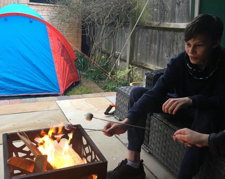 Teenager camps in garden for a month