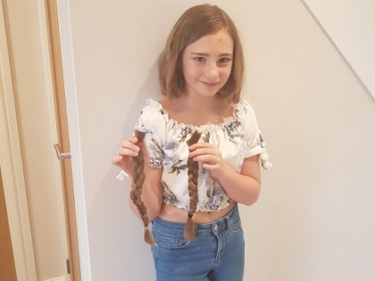 School Girl Lops Off Hair For Charity