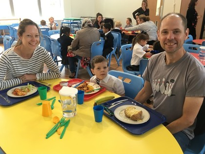 Parents dine with young pupils